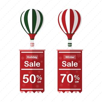 Wakacje i zimy etykiety sprzedaży wiszące z powietrza balon na białym tle