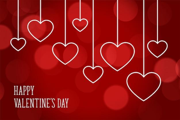 Walentynki czerwony bokeh piękne serca z życzeniami