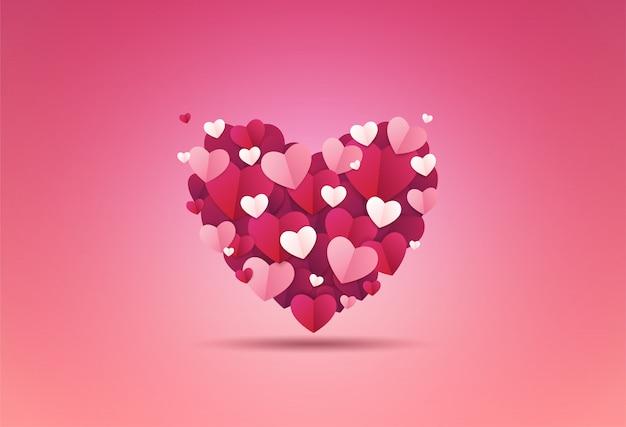 Walentynki-dzień tło. serce zdobi mały papier w kształcie serca.