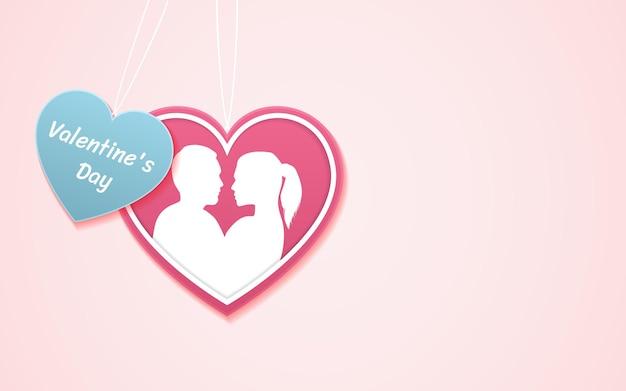 Walentynki i sylwetka całująca się para w kształcie serca wycięty na różowo