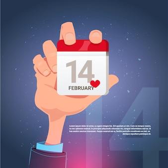 Walentynki kartkę z życzeniami z ręki trzymającej kalendarz 14 lutego dzień szablon tło z miejsca na kopię