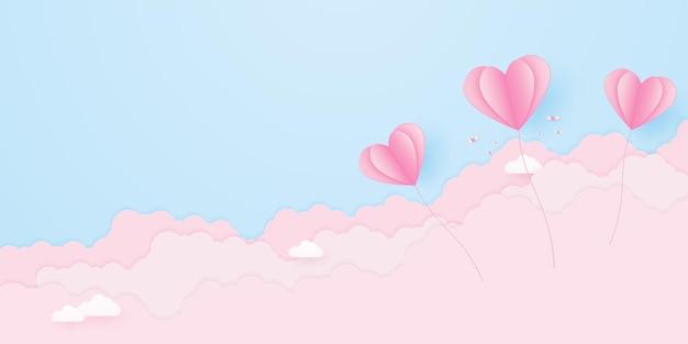 Walentynki miłość koncepcja tło różowe balony w kształcie serca unoszące się na niebie z chmurą