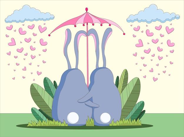 Walentynki para ładny króliczek pod parasolową kartą