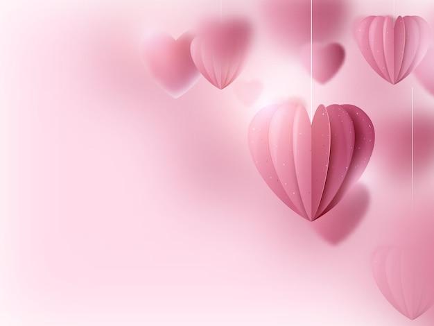 Walentynki. wiszą różowe serca i chmury.