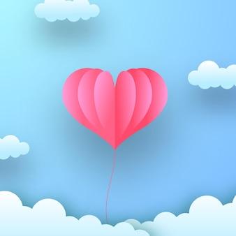 Walentynkowa kartka okolicznościowa miękka pastelowa miłość romantyczna dekoracja z wyciętym z papieru balonem w kształcie latającego paleniska na niebieskim pastelowym niebie