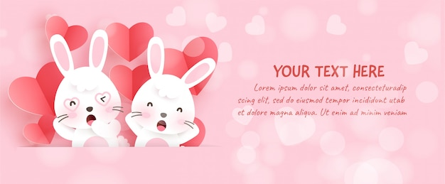 Walentynkowy sztandar z słodkimi królikami i papierowym sercem w stylu cięcia papieru.