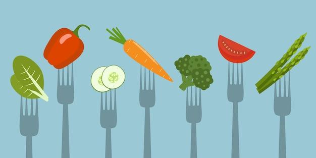 Warzywa na widelcach. zdrowe jedzenie.