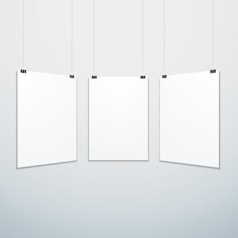 Wektor pionowy biały pusty plakat zestaw zawieszony na zaciskach biurowych makieta realistyczny cień pusty szablon na białym tle biały szary tło