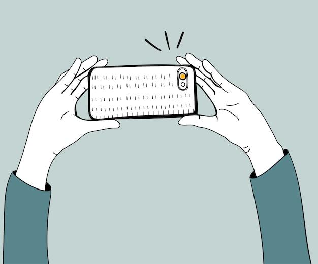 Wektor ręki bierze fotografię z smartphone