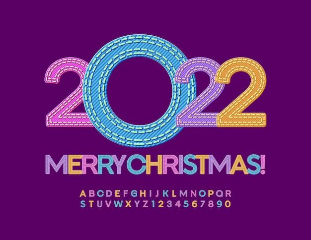 Wektor stylowe kartkę z życzeniami wesołych świąt 2022 denim kolorowy zestaw liter alfabetu i cyfr