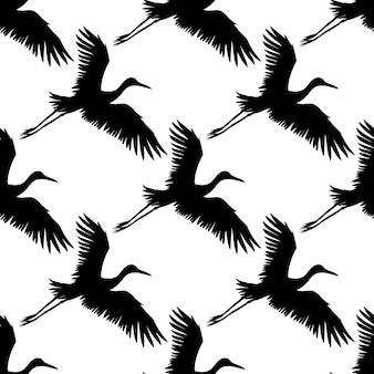 Wektor wzór czarnej ręcznie rysowanej sylwetki latającego żurawia ptaka