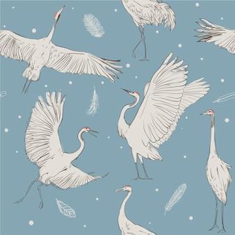 Wektor wzór z białymi żurawiami na niebieskim tle
