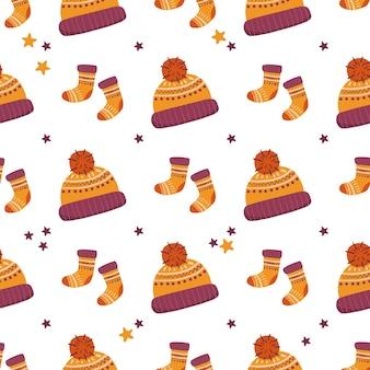 Wektor wzór z czapki skarpetki i gwiazdy na białym tle czas zimowy