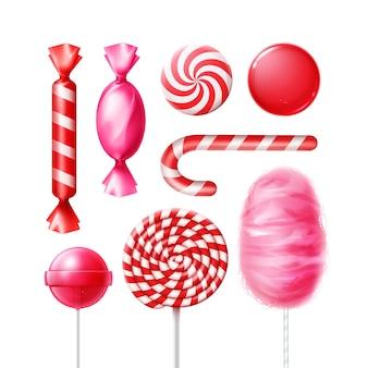 Wektor zestaw różnych słodyczy w różowych, czerwonych pasiastych opakowaniach foliowych, wirowych lizakach, lasce bożonarodzeniowej i wata cukrowa na białym tle