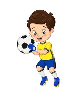 Wektorowa ilustracja kreskówka mały chłopiec trzyma piłkę nożną