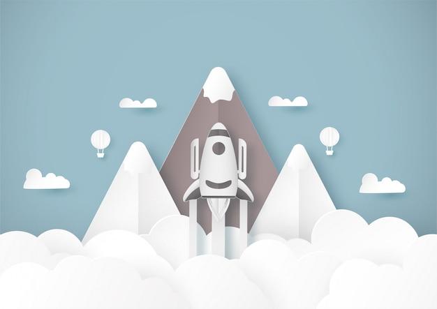 Wektorowa ilustracja z zaczyna pojęciem w papieru cięciu, rzemiośle i origami stylu. rakieta na niebie.