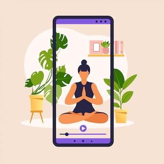 Wellness i zdrowy styl życia w domu. kobieta robi ćwiczenia jogi. baner jogi online z młodą dziewczyną w ekranie asany, roślin domowych i smartfona. ilustracja.