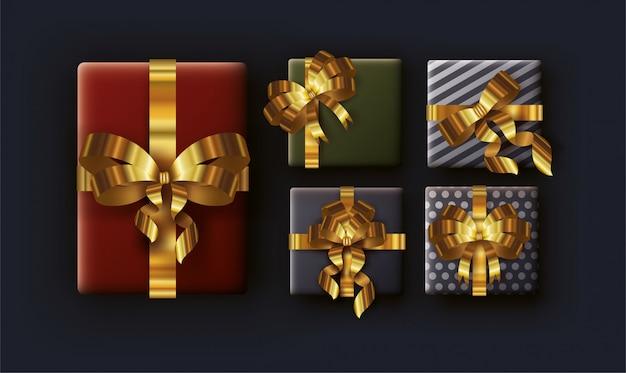 Wesołe kartki świąteczne z prezentami i złote wstążki