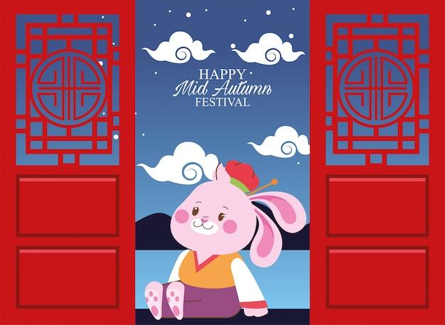 Wesołego festiwalu połowy jesieni z królikiem w drzwiach