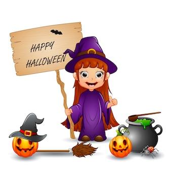 Wesołego halloween z małą czarownicą trzymającą list drewniany znak