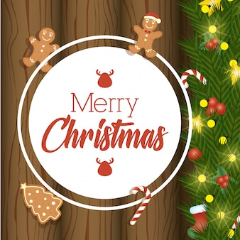 Wesoło kartka bożonarodzeniowa z słodkimi imbirowymi ciastkami na drewnie