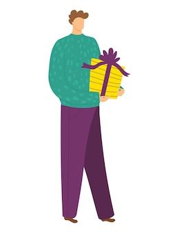 Wesoły szczęśliwy charakter trzymać prezent świąteczny prezent