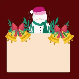 Wesołych świąt bożego narodzenia bałwan ze złotymi dzwonkami i pustą ramą plakatu