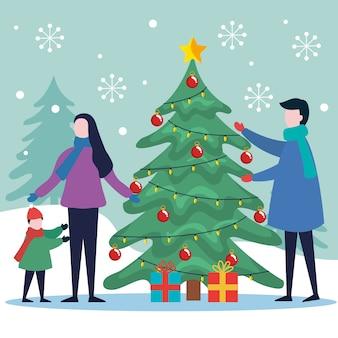 Wesołych świąt bożego narodzenia matka i syn z sosną i prezentami