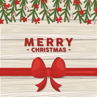 Wesołych świąt bożego narodzenia napis karty z kokardą i liśćmi w podłoże drewniane