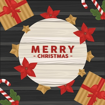 Wesołych świąt bożego narodzenia napis karty z kwiatami i prezentami w tle drewniane