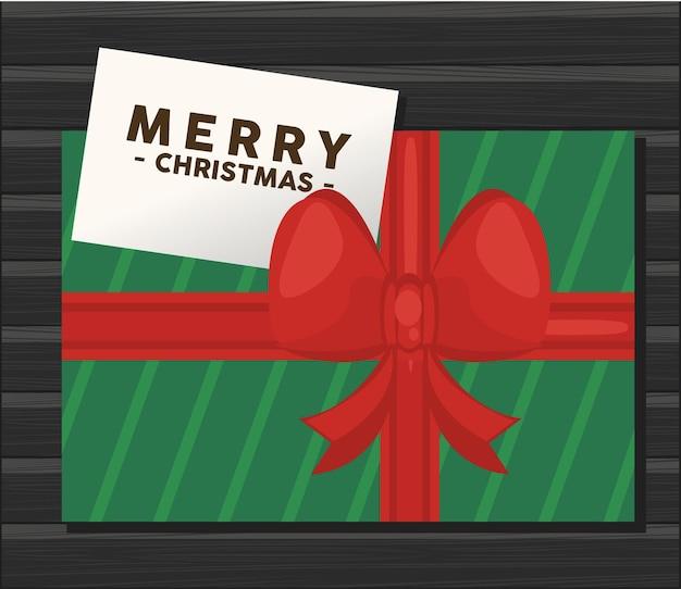 Wesołych świąt bożego narodzenia napis karty z zieloną ilustracją prezent