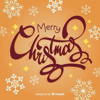 Wesołych świąt bożego narodzenia napis z płatki śniegu