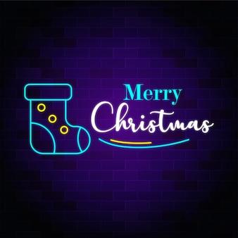 Wesołych świąt bożego narodzenia neonowy tekst z świąteczną skarpetą premium