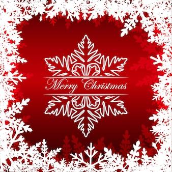 Wesołych świąt bożego narodzenia pozdrowienia na czerwono z ramą z płatki śniegu