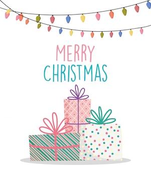 Wesołych świąt bożego narodzenia pudełka na prezenty i haging światła