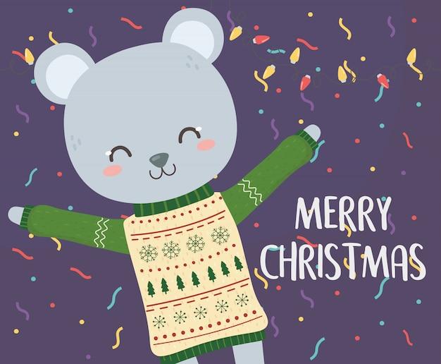 Wesołych świąt bożego narodzenia słodki miś z sweter światła i konfetti