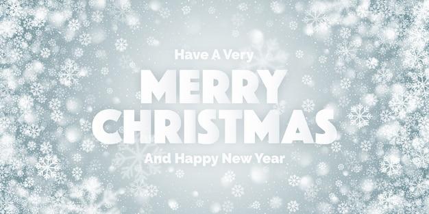 Wesołych świąt bożego narodzenia tekst i białe płatki śniegu
