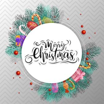 Wesołych świąt bożego narodzenia tekst w kółku z cukierkami, pudełkiem i liśćmi