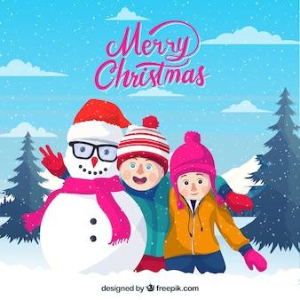 Wesołych świąt bożego narodzenia tło z dziećmi i ich bałwana