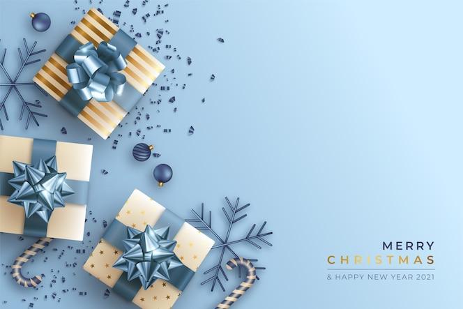 Wesołych świąt bożego narodzenia tło z realistycznymi prezentami