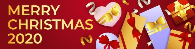 Wesołych świąt bożego narodzenia transparent z dużą ilością pudeł prezentowych