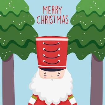 Wesołych świąt bożego narodzenia uroczy żołnierz dziadek do orzechów z kapeluszem i drzewami