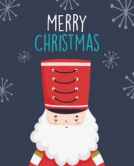 Wesołych świąt bożego narodzenia uroczy żołnierz dziadek do orzechów z kapeluszem