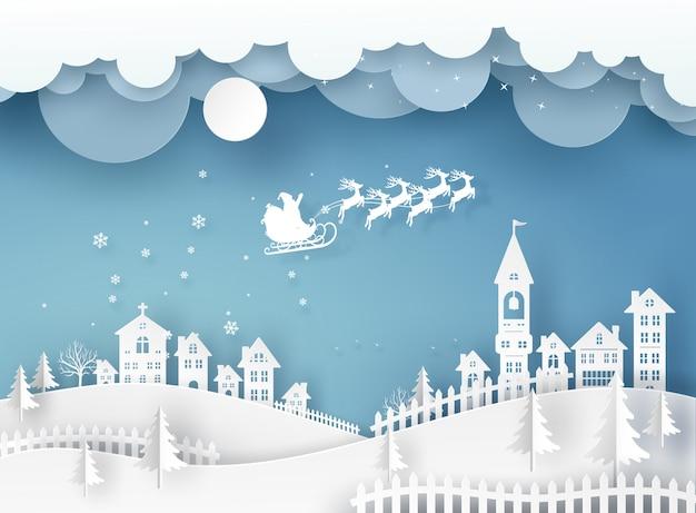 Wesołych świąt bożego narodzenia w zimowy pejzaż z domów i budynków i święty mikołaj na niebie