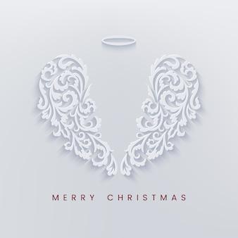 Wesołych świąt bożego narodzenia wycinana z papieru karta ze skrzydłami anioła