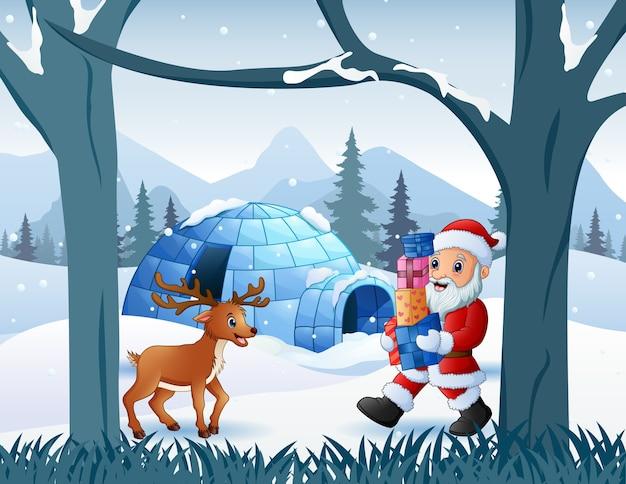 Wesołych świąt bożego narodzenia ze świętym mikołajem i jeleniem w pobliżu igloo