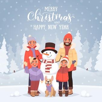 Wesołych świąt i nowego roku kartkę z życzeniami z napisem. rodzina z bałwanem na tle zimowego krajobrazu. wakacje w okresie świątecznym.
