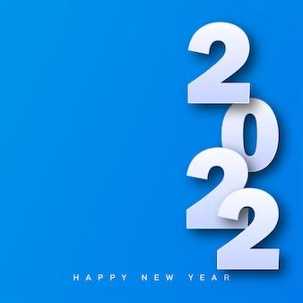 Wesołych świąt i szczęśliwego nowego roku 2022 karta na niebieskim tle. wektor