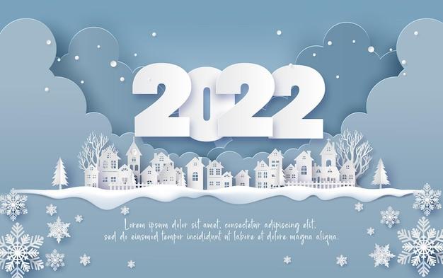 Wesołych świąt i szczęśliwego nowego roku 2022 , wiejska wioska w zimowym papierowym kolażu i wycinanym papierze z cyfrowym rzemiosłem .