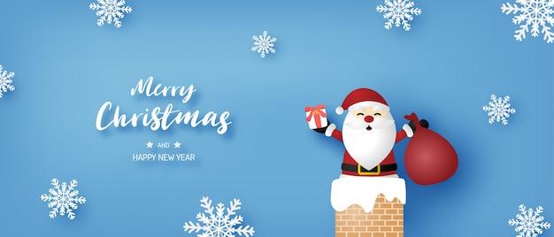 Wesołych świąt i szczęśliwego nowego roku banner z santa claus i płatki śniegu na niebieskim tle.